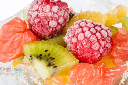 Background from appetizing fresh fruit salad. Dessert. photo