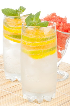 Summer fruity drink with ice on a white background. Stock Photo - 7338404