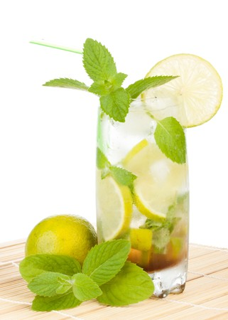 Mojito cocktail with lime, leaves of mint and pieces of ice on a white background photo