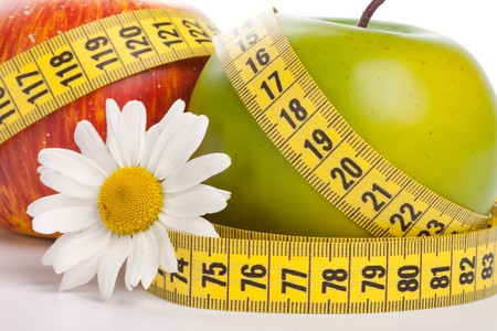 diet concept: Apples, flower and measuring tape. Concept of healthy food. Stock Photo