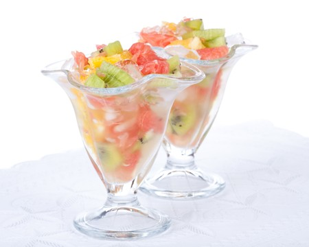 Fresh fruit salad on a white background. Dessert. photo