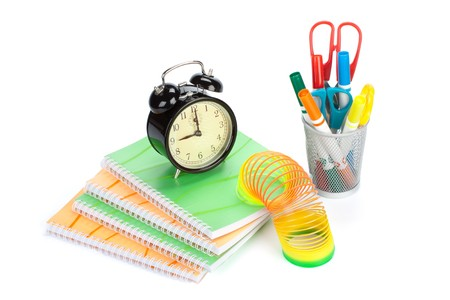 Pile of writing-book and alarm clock on a white background. Concept for Back to school Stock Photo - 7531843