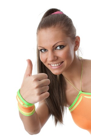The beautiful girl in an orange suit on a white background. Fitness. Stock Photo - 7638626