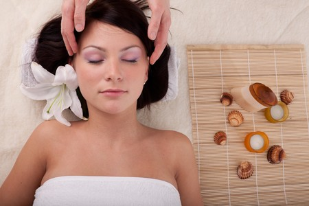 Young beautiful woman getting spa treatment  on a  white background Stock Photo - 7790109
