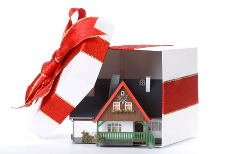 House model in a gift box on a white background. Seasonal discounts. photo