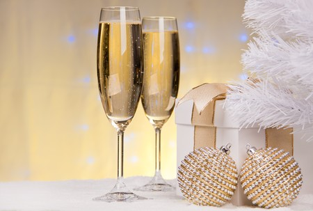 Champagne, gift box, snow and christmas toys. photo