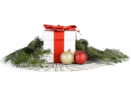 Fir-tree branch, gift box and banknotes on a white background. Stock Photo - 8032590