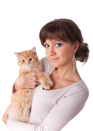 to cuddle: The happy young woman with a small amusing kitten on a white background.
