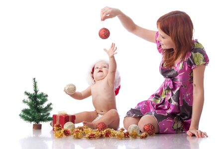 Baby and mum with Christmas  decoration on a white background. Stock Photo - 8162245