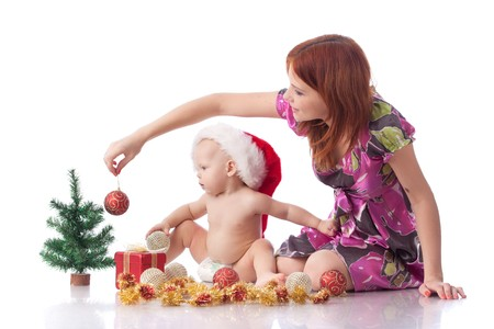 Baby and mum with Christmas  decoration on a white background. Stock Photo - 8162244