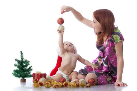 Baby and mum with Christmas  decoration on a white background. Stock Photo - 8306863