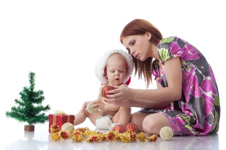 Baby and mum with Christmas  decoration on a white background. Stock Photo - 8306838
