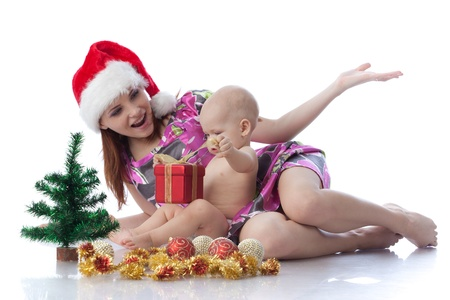 Baby and mum with Christmas  decoration on a white background. Stock Photo - 8306836