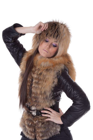 Young woman in fur   on a white background. photo