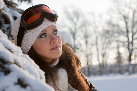 ski goggles: Young sporty woman in ski glasses. Outdoors.