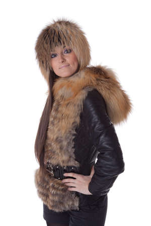 Young woman in fur   on a white background. Stock Photo - 8494646