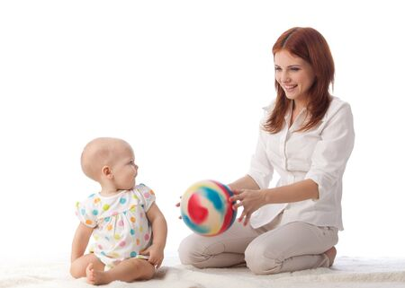 baby girl playing: Mother with sweet small baby on a white background. Stock Photo