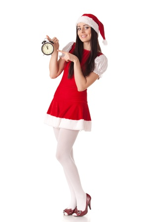 Pretty young woman in Santa's suit with alarm clock on a white background. Stock Photo - 8543451