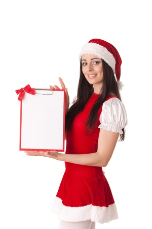 Pretty young woman in Santa's suit with clipboard on a white background. Stock Photo - 8543472
