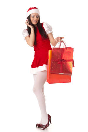 Pretty young woman in Santa's suit with shopping bags on a white background. Stock Photo - 8543452