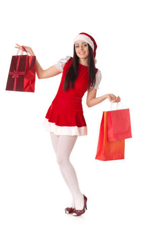 Pretty young woman in Santa's suit with shopping bags on a white background. Stock Photo - 8543455