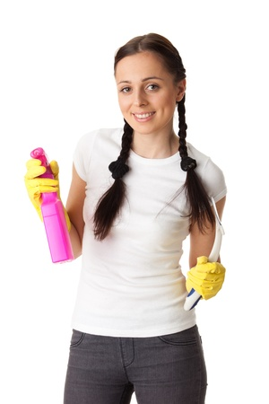 office cleanup: Young woman with spray bottle and brush on a  white background.  Housekeeping.