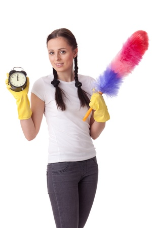 Young woman with alarm clock and whisk on a  white background.  Housekeeping. Stock Photo - 8543473