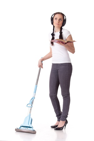 Young woman with mop and book on a white background. Housekeeping. photo