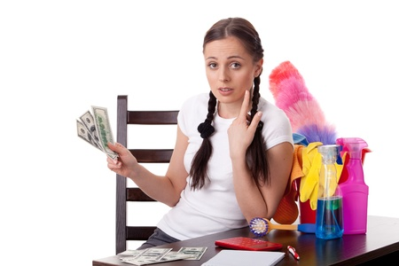 The young housewife plans the family budget on a white background. Stock Photo - 8543450