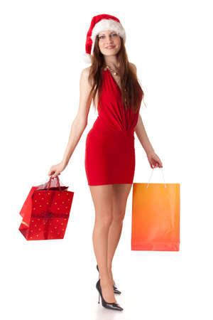 Pretty young woman in Santa's suit with shopping bags on a white background. Stock Photo - 8546966