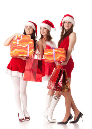 Pretty young women in Santas suit with shopping bags on a white background. photo