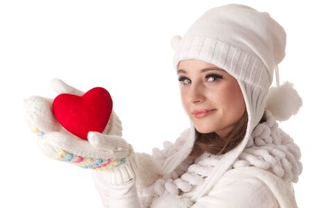 The beautiful young woman holds in hands a red heart on a white background. Stock Photo - 8546971