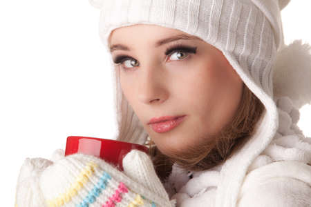 Young beautiful woman in winter warm clothes with red cup on a white background. Stock Photo - 8597132