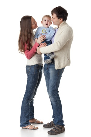 Young parents with their  sweet  baby on a white background. Happy family. Stock Photo - 8672784