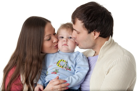 Young parents with their  sweet  baby on a white background. Happy family. photo