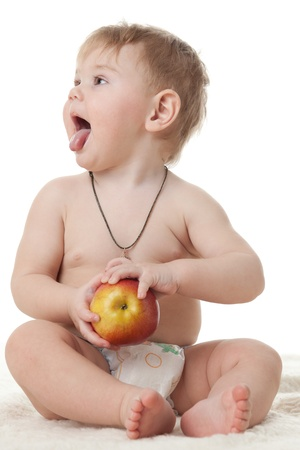 Sweet small baby with a fresh red apple on a white background. Stock Photo - 8672757