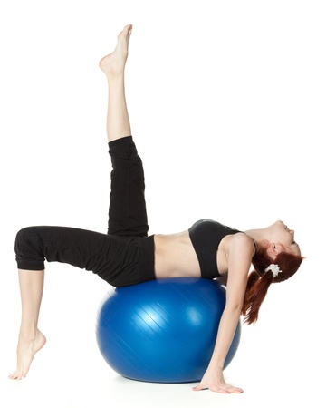 pilates ball: Young beautiful woman with gymnastic ball on a white background.