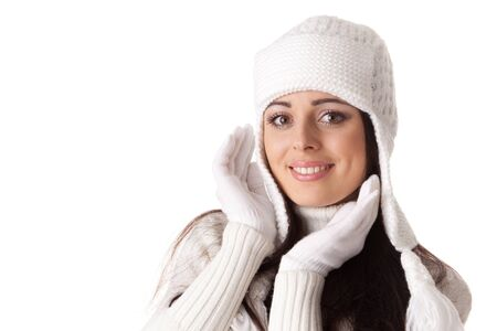 Beautiful young  woman in winter clothes on a white background. photo