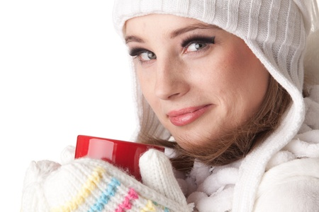 Young beautiful woman in winter warm clothes with red cup on a white background. Stock Photo - 8672892