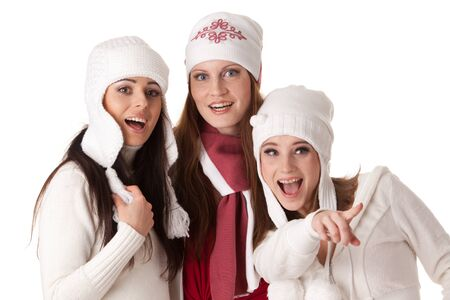 Beautiful young  women in winter clothes on a white background. photo