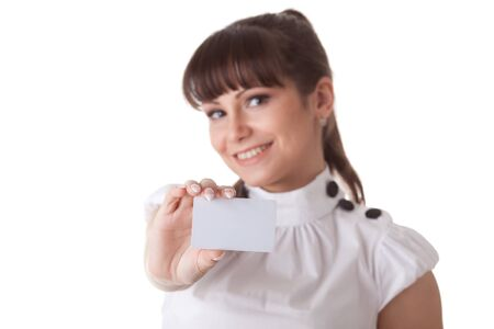 The beautiful businesswoman showing a blank business card on a white background. Selective focus on card. photo