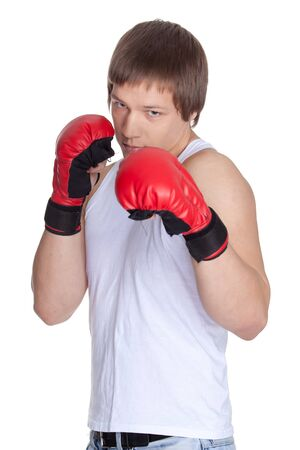 Young sporty man  in red fighting gloves on a white background. photo