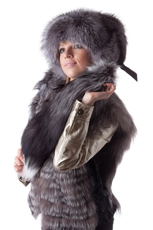 Young woman in fur   on a white background. Stock Photo - 8732939