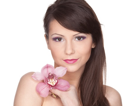 Portrait of a beautiful young woman with a flower on a white background. photo