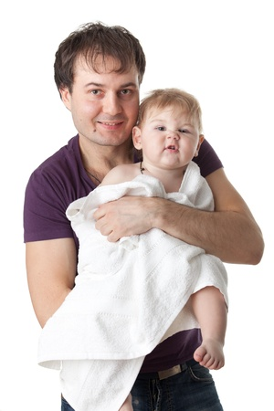 Young  father and his sweet baby with towel on a white  background. Happy family. photo