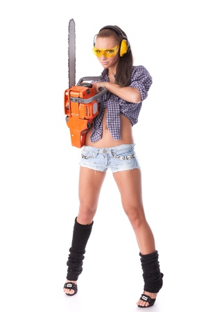The young woman with a chainsaw on a white background. Stock Photo