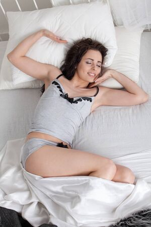 Portrait of beautiful young woman sleeping in bed at home. photo