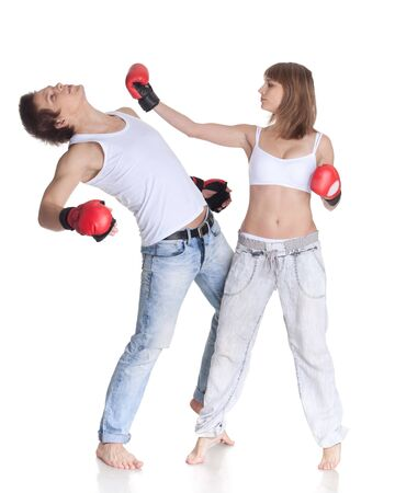girl punch: Sporty young couple in red fighting gloves on a white background.