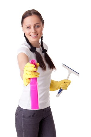 Young woman with spray bottle and brush on a  white background.  Housekeeping. Selective focus on bottle