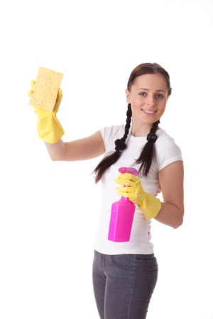 office cleanup: Young woman with spray bottle and sponge on a  white background.  Housekeeping.